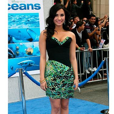 <p>This BCBG dress is one of our fave dresses that we've seen Demi wear. It's age appropriate (she was only 17 at the time) and a perfect fit. We're totally coveting the singer's shoe collection.</p>
