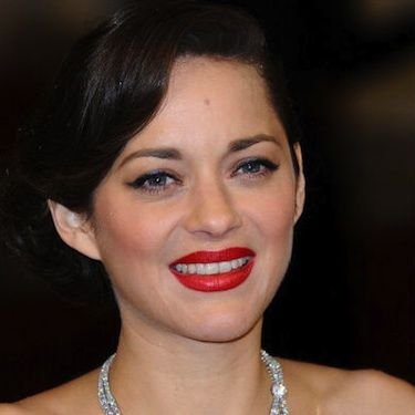 <p>We always catch ourselves gawking over actress Marion Cotillard's effortlessly chic red carpet style. She showed up at the 2013 BAFTAs with her hair tucked into a low side chignon hairstyle, soft cat-eye makeup and brilliant matte red lips. We thought she looked absolutely flawless, as always!</p>
