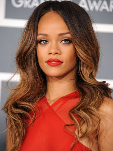 <p>Ditching the 90s grunge guise for the night, Rihanna went for ladylike glamour at the GRAMMY Awards. Her classic brown smoky eyes looked beautiful against her curly ombre hair and the matte scarlet lipstick matched her red hot dress perfectly.  </p>