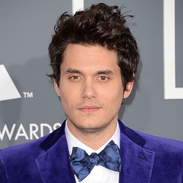 If you're dating someone as eccentric as Katie Perry you need to be able to make a bold fashion statement or two. John Mayer rose to the challenge though at the 2013 Grammy Awards in a velour purple jacket and tie. We think he passed.