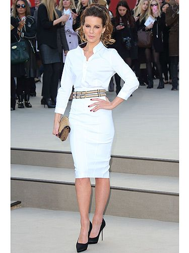<p>Smarty pants Kate Beckinsale (she studied at Cambridge, dontcha know?) arrived for the Burberry show looking a bit of all white during London Fashion Week. The brit babe kept things sleek in her white pencil skirt and white blouse combo. We approve, very much so.</p>