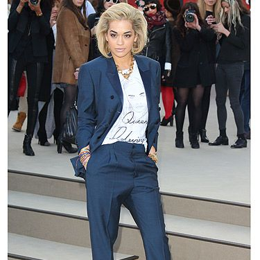 <p>Oh, you've gotta love Rita Ora! The pop superstar seemed to have undergone something of a fashion week makeover before heading to the Burberry show, going from rebel girl to grown up lady. And would you look at the T-shirt she's wearing? It says 'Queen Delevingne' on the front. We want one!</p>