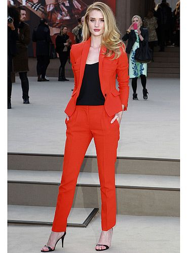 <p>Bombshell alert! Rosie Huntington-Whiteley rocked red like a pro as she made her way into the Burberry Prorsum London Fashion Week show. Seriously, how can she ooze this amount of sex appeal? Teach us Rosie, please!</p>