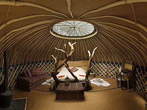 """<p>An 18-foot yurt situated in a clearing overlooking a fishing pond at lovely Crafty Camping in Dorset. Inside you'll find a seagrass floor, colorful wall hangings, a wood burner and a one-of-a-kind hand crafted wooden bed covered in a heavy duvet and blankets to keep things snug. Outside you've got your own deckchairs and hammock, plus a woodland dining table with logs for chairs, or, if you're feeling more social, head down to the woodland kitchen or sauna yurt. There's also an abundance of courses at Crafty Camping, you can even make your own chair! <br /><em></em></p> <p><em>From £100 per night (sleeps 2),</em> <a href=""""http://www.canopyandstars.co.uk/coracle"""" target=""""_blank"""">canopyandstars.co.uk/coracle</a><em> </em></p>"""