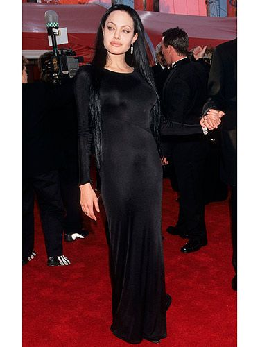 Was Angelina Jolie channeling Morticia Adams when she turned up at The Academy Awards in this head-to-toe black ensemble? The ultra long sleek black hair and floor-length, pale makeup and long-sleeved black dress made nothing to deter from the gothic chick image she was trailing at the time (remember those blood vials?). We'll forgive her though, since meeting Brad Pitt and becoming a mum she's toned down her image and always looks gorgeous on the red carpet.