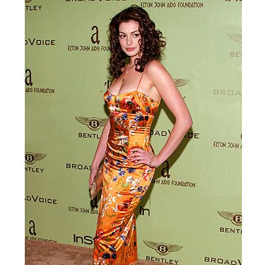 Before Anne Hathaway hit it really big and became one of the best dressed actresses on the red carpet, she wore this orange number at Elton John's Oscars party back in 2004. The colour, print and Anne's hair are all a little bit Ab Fab. Thankfully Anne has since redeemed herself so we'll put this down to young age.