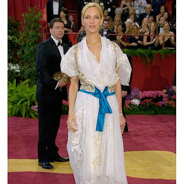 """In a twist of fashion fate, when Uma Thurman went to the 2004 Oscars she changed outfits at the last minute and chose this interesting Christian Lacroix number. The fluffy sleeves, embellished gillet and lace earned her the title 'Swiss Miss' – ouch. Luckily Uma saw the funny side and said: """"Everyone looked the same, everyone had it down to such a perfect T. You get bored. That's when you have to say, 'I will be worst-dressed'."""""""