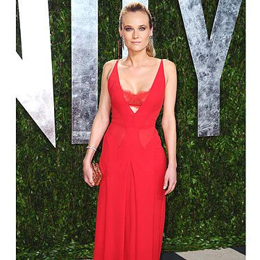"""<p>Diane Kruger went for the slink-factor in this lipstick-red <span class=""""st""""> Atelier Versace</span> gown with peek-a-boo cut-out section just below the bust</p>"""