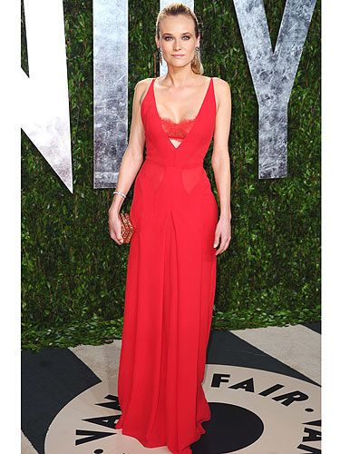 "<p>Diane Kruger went for the slink-factor in this lipstick-red <span class=""st""> Atelier Versace</span> gown with peek-a-boo cut-out section just below the bust</p>"