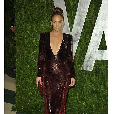 Jennifer Lopez swapped one revealing Zuhair Murad plunging v-neck dress for another at the Vanity Fair Oscar Party&#x3B; this time a deep red gown, and thankfully no nip-slip for J-Lo second time round! It's worth noting that we're in lust with her red to black ombre crystal Allegro clutch by Swarovski - divine!