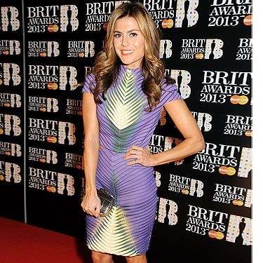 """<p>Zoe Hardman arrived at the Brit Awards looking pretty in purple. Award ceremonies are the perfect occasion for celebrities to wear big designer names, but Zoe opted for new talent. This incredible dress was designed by <a href=""""http://www.fashion.arts.ac.uk/"""" target=""""_blank"""">London College of Fashion</a> graduate Yie Xie. Yie was part of London College of Fashion's MA showcase and LFW debut at the Royal Opera House. The ITV presenter wore 'Elenor' shoes from Kurt Geiger's new brand Jessica Simpson. You can get your hands (or feet) on them at <a href=""""http://www.kurtgeiger.com/women/elenor-purple-suede-40-jessica-simpson-shoe.html"""" target=""""_blank"""">kurtgeiger.com</a>.</p>"""