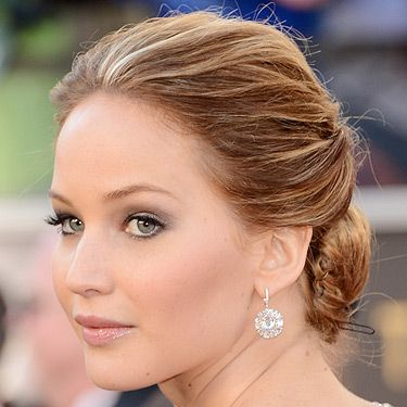 """<p>Actress Jennifer Lawrence looked fantastic in that messy updo hairstyle at the 2013 Academy Awards. The Silverlinings Playbook star opted for a very soft, bridal-inspired beauty look with those pretty pink lips and cheeks. We're totally voting on Jennifer to take home the award for Best Actress! *fingers crossed*</p><p> </p><p><a title=""""http://www.cosmopolitan.co.uk/beauty-hair/news/styles/oscars-2013-celebrity-hair-trends"""" href=""""http://www.cosmopolitan.co.uk/beauty-hair/news/styles/oscars-2013-celebrity-hair-trends"""" target=""""_self"""">SEE THE OSCARS 2013 HAIR TRENDS</a></p>"""