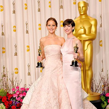 """<p>Jennifer Lawrence and Anne Hathaway both scooped Academy Awards at the Oscars 2013, and they both wore dresses in the palest of hues. Coincidence? We think not!</p><p>JLaw, who took home the Best Actress award for Silver Linings Playbook, looked as pretty as a princess in her strapless Dior Haute Couture gown. Clearly it's a dress for posing, not moving in, as the poor love tripped on the train whilst collecting her award. Gah.</p><p>Meanwhile, AHaw (what?) channeled Audrey Hepburn in a soft pink Prada dress, paired with Tiffany & Co jewels. Perfect.</p><p>Who says pale can't be interesting?</p><p><a title=""""Oscars 2013"""" href=""""http://www.cosmopolitan.co.uk/celebs/entertainment/oscars-2013"""" target=""""_self"""">SEE MORE FROM THE OSCARS 2013!</a></p>"""