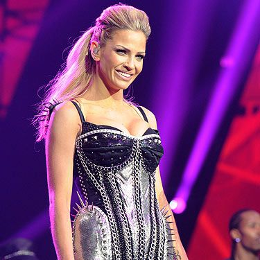 <p>Sarah Harding looked back on form as she took to the stage with her fellow Girls Aloud bandmates. The blonde-haired beauty kept relatively quiet compared to the rest of the girls, but we still love her!</p>