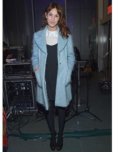 Sigh. We want to BE Alexa Chung, the girl has an impressive wardrobe. The style maven pulled off the winter pastel trend with minimal effort in a powder blue winter coat at the The Armory Party at MOMA. She teamed her coat with her outfit de rigueur; a white Peter Pan collar blouse, LBD and a pair of black platform shoes. Perfect.