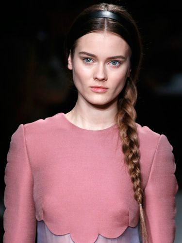 "<p>The simple side plait is back making us very, very happy! At Valentino the models wore theirs with centre partings topped with flat black Alice bands in the centre of the head. Effortless elegance at its best.</p> <p>To get the look style your plait loosely at the top, getting tighter towards the bottom and secure with a clear elastic. Ensure a high-shine finish with some <a title=""http://www.tesco.com/groceries/Product/Details/?id=276825137"" href=""http://www.tesco.com/groceries/Product/Details/?id=276825137"" target=""_self"">L'Oréal Paris Elnett So Sleek</a>, £6.63. </p>"