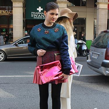 <p>The street style snappers couldn't get enough of this fashionista working a super-fabulous look at Paris Fashion Week. Checking out that is-it-actually-a-giant-sweet-wrapper clutch bag? It is, in fact, a Martin Margiela for H&M number we're loving rather a lot.</p>