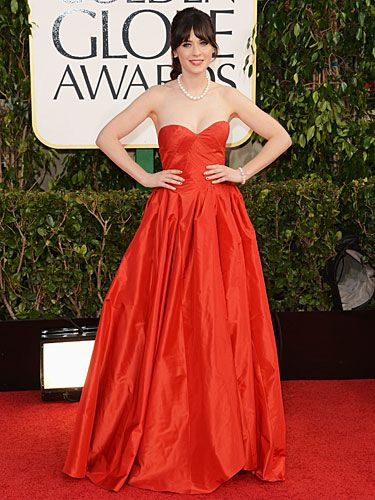 "<p>Yes! It's Zooey Deschanel. The New Girl star looked ravishing in red at the 2013 Golden Globe Awards. The fairytale frock was Oscar De La Renta, and she obviously teamed her look with quirky nail art.</p> <p><a title=""http://www.cosmopolitan.co.uk/beauty-hair/news/beauty-news/zooey-deschanel-wears-film-strip-nail-art-at-2013-golden-globe-awards"" href=""http://www.cosmopolitan.co.uk/beauty-hair/news/beauty-news/zooey-deschanel-wears-film-strip-nail-art-at-2013-golden-globe-awards"" target=""_blank"">CHECK OUT ZOOEY'S RED CARPET NAILS</a></p>"