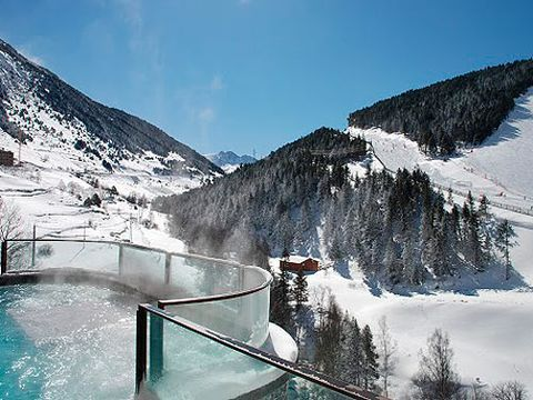 "<p>Floating in a bubbling hot tub, doused in glorious sunshine while looking out over the snow-frosted peaks is the ultimate in alpine luxury. The Sport Wellness Mountain Spa in Soldeu is a veritable playground for a spa junkie. At 1850-metres high, the five floors boast everything from an aromatherapy relaxation room to an ice pit. There's an indoor-outdoor pool, an abundance of water features and an entire glass wall overlooking the slopes. You can be massaged, steamed, sprayed, dunked and generally indulged until finally you're rewarded with a glass of champagne and some sushi in the hotel's Glass Bar.<br /><em>Spa access is free for hotel guests or €49.16 for a day pass; for more details visit <a href=""http://www.sportwellness.ad/en"" target=""_blank"">sportwellness.ad/en</a>.</em></p>"