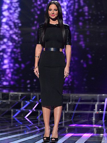 <p>Tulisa went for a sleek, groomed look on the results show of X Factor by wearing a black dress by Victoria Beckham teamed with Alexander McQueen shoes. The 24-year-old X Factor judge has been dating Newcastle United ace Danny Simpson for three weeks and although their relationship got off to a rocky start, Tulisa has ignored the critics and launched fully into glam WAG mode. And who better to take notes from? One Queen of WAG, Victoria Beckham!</p>
