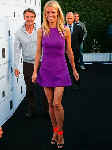 How stunning does Gwyneth Paltrow look in bright colours at the opening of the Tracy Anderson flagship in California? Gwynie showed off her tan in a mini purple Victoria Beckham dress, naturally, which she teamed with neon orange Michael Kors heels. And don't get us started on those pins! VB would be so proud!