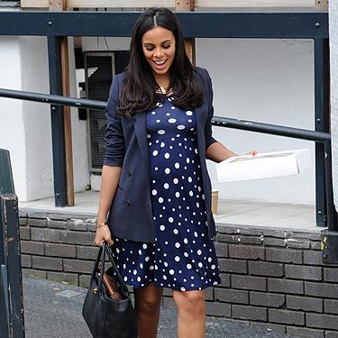 Another day, another great maternity look from Rochelle Humes. The Saturdays' singer didn't let her growing bump get in the way of her fashion sense as she was snapped leaving the ITV studios. Rochelle teamed her favourite stripy Dune heels with a navy polka dot dress and kept warm with a navy blazer for an uber-chic look.
