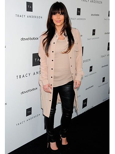 Is this Kim Kardashian's best maternity look yet? Although she's been spotted in a few unflattering outfits recently we think she looked super sleek at the Tracy Anderson flagship studio opening in California yesterday. The beige top and leather trousers combo with black courts did wonders for her figure, while her locks looked luscious.