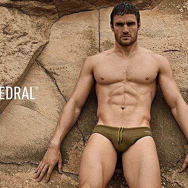 <p>Thom Evans, what LARGE... hands you have. Kelly Brook's boyfriend (grrr!) is modelling the SS13 collection of D.HEDRAL pants against a concrete backdrop. Sexy. The swim trunks, available in March, boast 'Anglefit' technology to create an improved and more tailored fit. Hmm, we're not really bothered either. </p>