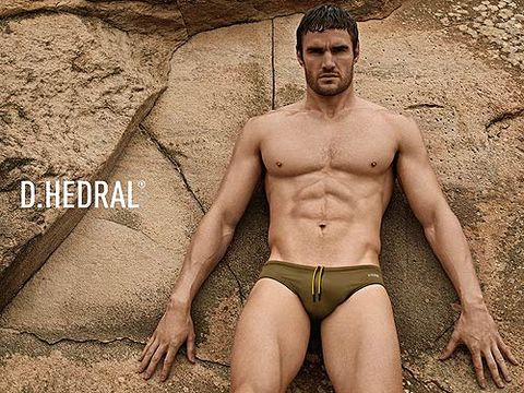 <p>Thom Evans, what LARGE... hands you have. Kelly Brook's boyfriend (grrr!) is modelling the SS13 collection of D.HEDRAL pants against a concrete backdrop. Sexy. The swim trunks, available in March, boast 'Anglefit' technology to create an improved and more tailored fit. Hmm, we're not really bothered either. </p> <p> </p>