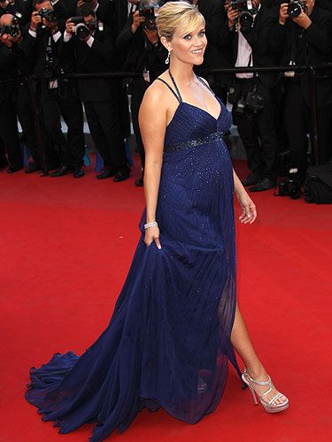 <p>Reese Witherspoon was looking blooming lovely on the Cannes red carpet in this midnight blue, sparkling gown. The star may be nearly six months pregnant but that didn't stop her looking entirely elegant in vertiginous silver heels and her hair in an elegant chignon.</p>