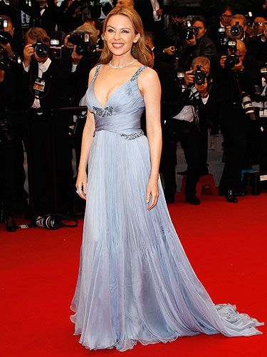 <p>Kylie Minogue glided up the red carpet for the Cannes closing ceremony in this pale-blue Roberto Cavalli gown with plunging neckline. The songstress is promoting her film Holy Motors and has been glitzing it up to the max on the red carpet for the film festival.</p>