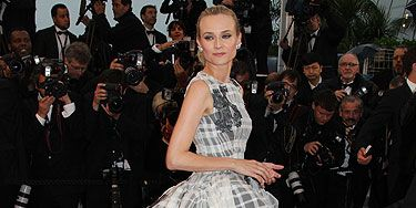 <p>Er, WOW, is all we have to say about Diane Kruger's spectacular Christian Dior Couture gown. The actress has looked incredible for the entire duration of the Cannes Film Festival but for the closing ceremony, she really went for it. This enormous gown with hip bustle going on was topped with a simple ponytail and subtly smouldering makeup. We're in love.</p>