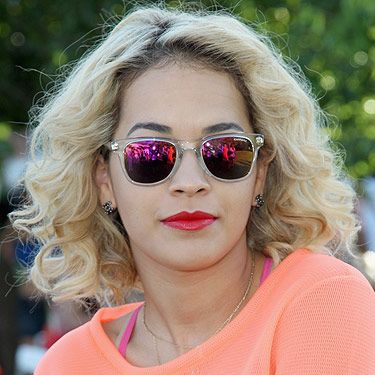 """<p>Rita Ora looked amazing in her reflective sunglasses as she sunned herself at the Lacoste L!VE Coachella Desert Pool Party. The singer's shades were Carrera by Safilo sunglasses (6000 L) in Crystal with a multilayer pink lens. At a mere £99, snap them up at <a title=""""http://www.monnierfreres.co.uk/gbuk/sunglasses/squared-frames/carrera-6000-sunglasses_p20865502.html?utm_medium=cpc&utm_campaign=shopstyle&utm_source=shopstyle"""" href=""""http://www.monnierfreres.co.uk/gbuk/sunglasses/squared-frames/carrera-6000-sunglasses_p20865502.html?utm_medium=cpc&utm_campaign=shopstyle&utm_source=shopstyle"""" target=""""_blank"""">Monnierfreres.co.uk </a>now!</p><p><a title=""""http://www.cosmopolitan.co.uk/fashion/shopping/coachella-festival-fashion-celebs-2013#fbIndex1"""" href=""""http://www.cosmopolitan.co.uk/fashion/shopping/coachella-festival-fashion-celebs-2013#fbIndex1"""" target=""""_self"""">MORE CELEBS ROCKING COACHELLA FESTIVAL</a></p>"""