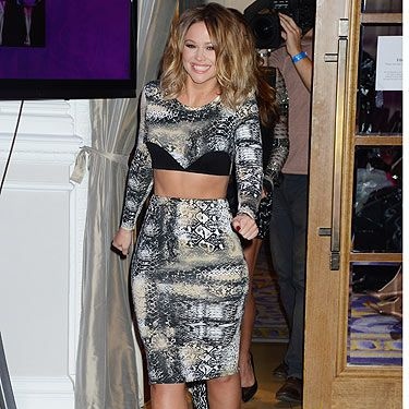 <p>Kimberley Walsh posed at a press conference to announce 'Girls Aloud Ten, The Hits Tour 2013' at The Corinthia Hotel in London. There's no denying the fact that she looked a compete beaut with her new cropped hair, pencil skirt and crop top. Nicely done Kim.</p>