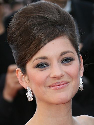 """<p>Channelling classic Cannes glamour, French screen star, Marion Cotillard showed off the ultimate beehive on the red carpet. Her makeup made things modern, with blue eyeliner on her lower lids and nude gloss on her lips. Stunning.</p> <p><strong>Get the look</strong> with a bit of backcombing and a lot of <a title=""""http://www.beautybay.com/haircare/sexyhair/bigwhatateasebackcombinabottle/?pcrid=12485385563&gclid=CI-ore36prcCFeXItAodNzoAzA"""" href=""""http://www.beautybay.com/haircare/sexyhair/bigwhatateasebackcombinabottle/?pcrid=12485385563&gclid=CI-ore36prcCFeXItAodNzoAzA"""" target=""""_blank"""">Sexy Hair Big What A Tease Backcomb In A Bottle</a>, £11.66</p>"""