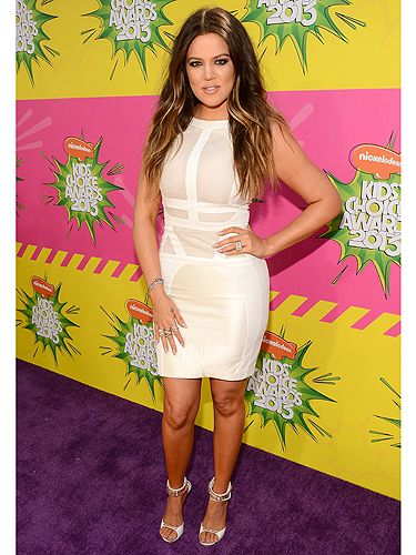 <p>Wow, could Khloé Kardashian look any hotter? The reality tv star clearly wasn't afraid of getting slime on her Antonio Berardi dress as she chose white to attend the 2013 Nickelodeon Kids' Choice Awards in LA. Khloé fitted her fabulous curves into a white bodycon style dress and accessorised with matching sandals and loads of bling.</p>