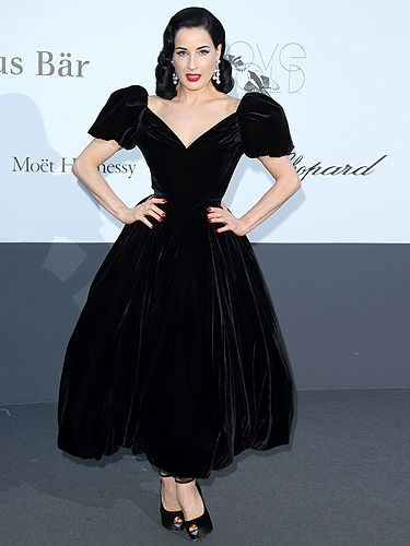 <p>Dita Von Teese does vintage like nobody else. The burlesque star arrived at amfAR's Cinema Against AIDS Gala looking ultra glam. The dress is a custom velvet creation by Ulyana Sergeenko – how much do you think it weighs? It looks very heavy. She teamed the look with classic Louboutin peep-toes and plenty of Chopard bling. This gal knows what she's doing.</p>