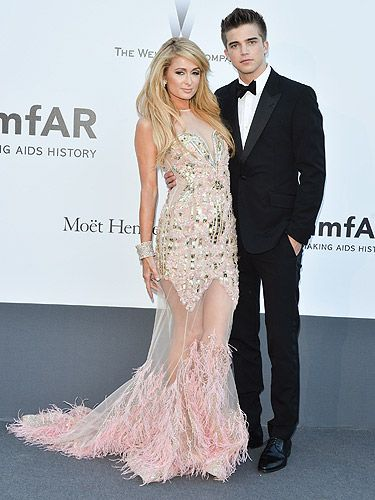 <p>Hello Paris! Paris Hilton has put herself back in the spotlight during Cannes Film Festival and we love it. The singer (yup, she's just signed a new music deal with Cash Money Records) arrived at amfAR's 20th Annual Cinema Against AIDS Gala with her beau, River Viiperi (who looked pretty hot in his tux).</p>