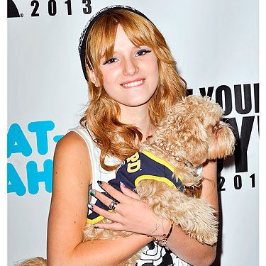 They say dog owners tend to resemble their pets and we can definitely see it in Bella Thorne and her pup. Only the matching hair colour mind! The Disney star showed off her cute dog at the Move Your Body 2013 event in New York, and dressed him appropriately in gym gear. Bless.