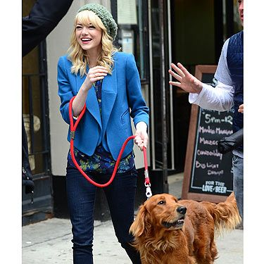 <p>It was bring your dog to work day yesterday for Emma Stone! The blondie was filming The Amazing Spider-Man 2 in New York and decided to bring her pet retriever Ren along to cuddle in between takes. She shares him with boyfriend and co-star Andrew Garfield so the lucky pooch probably got double the cuddles too!</p>