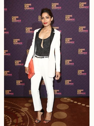 J'adore Freida Pinto's sharp white tux and black shirt combo - especially now she's vamped it up with a slick of bright red lippy. This lady clearly means business at Chime For Change!