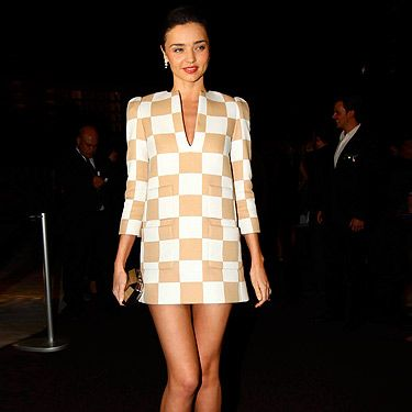 <p>Er, check out those legs! Proving that checks don't always have to be black and white, model Miranda Kerr rocks a short 60s style V-neck tunic, at the opening of Louis Vuitton's new store in Mexico.</p>