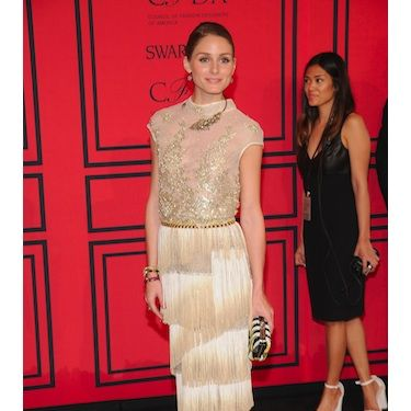 <p>Olivia Palermo looked as stylish as ever in a divine Dennis Basso Spring 2013 fancy fringed frock - we're guessing she was inspired by all that flapper fashion in The Great Gatsby! But, for us, it was all about those eclectic acessories&#x3B; think Sergio Rossi clutch and Zara lace up slingback boots for an update on a classic style.</p>