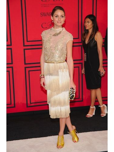 <p>Olivia Palermo looked as stylish as ever in a divine Dennis Basso Spring 2013 fancy fringed frock - we're guessing she was inspired by all that flapper fashion in The Great Gatsby! But, for us, it was all about those eclectic acessories; think Sergio Rossi clutch and Zara lace up slingback boots for an update on a classic style.</p>