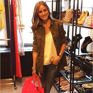 <p>Ah to be Olivia Palermo and have her amazing wardrobe (and cute dog). The reality TV star was 'Snapped: At The Office' in floral ballerina pumps, denim ankle grazers, a white blouse and khaki jacket. A chunky bracelet, watch and red tote finished off the casual chic look perfectly. Please can we get all the shoes in the background?</p>