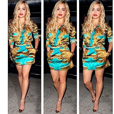 <p>After rocking two burgundy PVC cut-out dresses for an intimate gig at Sony HQ in London, Rita Ora finished off the evening in this silky gold and turquoise Katy Eary shirt dress, teamed with very cool gold tip heels. We adore her new extensions too, very glam. She posted the pic with the caption: 'Katy Eary to finish the night off. Goodnight guys!'</p>