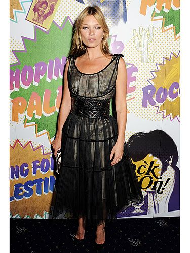<p>Kate Moss stole the spotlight at The Hoping Foundation Presents 'Rock On' Benefit Evening For Palestinian Refugee Children in London yesterday. The model took the 'Rock On' theme seriously by wearing a gold dress with black tulle overlay, clinched in at the waist by a black leather belt. She finished off her look with black courts and a leopard print clutch. A flick of black eyeliner and un-styled hair added to the rock theme. We'd expect nothing less from you Kate.</p>