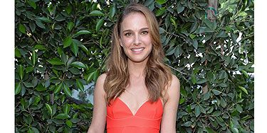 <p>Natalie Portman's media appearances are rare, but when she does get snapped at an event, her outfits never disappoint. She pulled out all the stops to support hubbie Benjamin Millepied yesterday at his L.A. Dance Project Inaugural Benefit Gala. Being the face of Dior fragrance, it's only natural the brunette opted for a dress by the French Haute Couture house. The tomato red dress with sweetheart neckline and dip hem suited her petite frame perfectly and we love the little flash of pink from the lining. She accessorised with cream and white strappy sandals and a black Richard Millie watch. She opted for a natural beauty look, with tousled hair and nude makeup. </p>