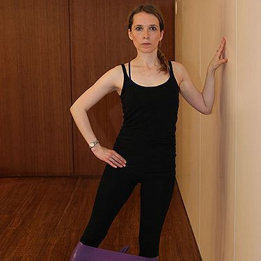 <p><strong>Works:</strong> Outer hips, thighs and glutes<br /><br />Keeping the resistance band in the same place, stand with your left side to a wall and place your left hand on the wall elbow bent. Micro bend the supporting knee without leaning into the wall, flex the right foot and leading with the right heel lift out to the right and bring the leg back in – repeat for 10 hold it out and pulse for 10. Repeat on the other side.</p>