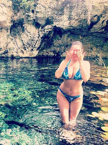 """<p>Kelly Brook is on holiday AGAIN, and we are beyond jealous. Destination envy? Check. Bikini envy? Check. Beach body envy? Yep, you got it – check. The professional holiday-goer tweeted this picture during her trip to Mexico, with the caption: """"#HealingWater #Beauty #Cleanse #Restore #MorningSwim #MayanRiviera #Cenotes."""" All those hashtags have made us want to book a flight pronto. Pictures have emerged of Kelly sunbathing topless – and they've caused a little controversy. In this month's Cosmo, we asked the fellas what THEY thought of women sunbathing without their bikini top on, find out what they thought in the <a href=""""https://itunes.apple.com/gb/app/cosmopolitan-uk/id461363572?mt=8"""" target=""""_self"""">July issue</a>, out now.</p>"""